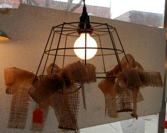 wire basket frame with hand tied burlap bows on a twist cotton covered electric cord