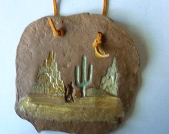 Southwestern art Clay Wall hanging cactus and Desert scene, hanging by rawhide loop.