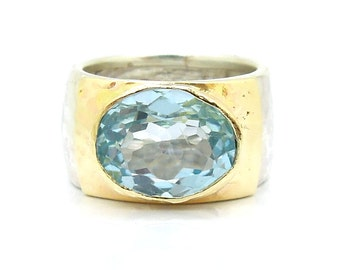 Blue topaz ring oval stone hammered silver & yellow gold band