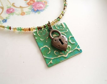 Heart of the Matter - Heart Charm Necklace, Embossed, Patina, Beaded Necklace, Green, Romantic, Whimsical, Lock Charm,  Classic Necklace