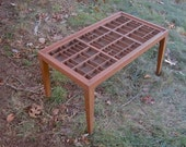 Coffee table made in cherry wood with a reclaimed letterpress type box top.