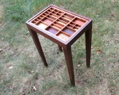 End or side table with a letterpress type tray top with colored wood inlays.