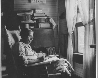 Image 8 1/2 x 11 suitable for framing. Black Americana woman reading.