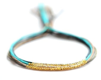 Gold beads on Turquoise silk friendship bracelet. Silk bracelet. Modern bracelet.