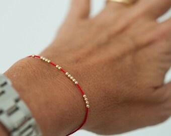 SOLID 14K GOLD delicate friendship bracelet on red silk cord, modern bracelet, minimalist bracelet