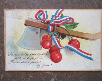vintage postcard - HATCHET and CHERRIES, chopping down the cherry tree - copyright 1900s - PC217