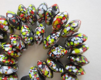 10 glass beads - spatter glass, speckled, confetti - trade beads, bicone saucer shaped