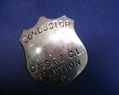 vintage CONDUCToR BADGE - G.W.S.F.& C.L. TRACTiON Co.