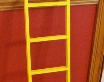 small handmade yellow display wood ladder