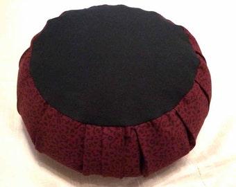 Zafu meditation cushion, Dark Burgundy Print and solid black cotton twill, filled with buckwheat hulls.