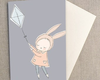 "Greeting Card - Bunny Rabbit Girl Flying a Kite, Slate Blue, Gray Blue -  C6 greeting card 11w x 15.5 h cm (4.4x6.1"")."