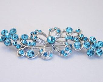 Vintage light blue rhinestone crystal brooch.  Flower design. Blue brooch