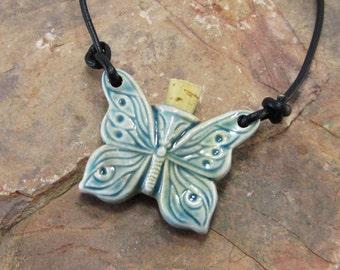 Peruvian Ceramic Raku Butterfly Wings Bottle