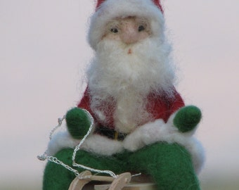 Needle felted Santa Claus on sledge