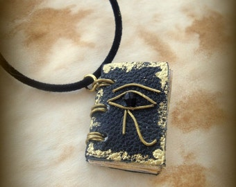 The Eye of Horus Egyptian Mini Book Necklace  by Dryw on Etsy