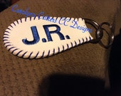 Keychain made from a baseball, embroidered with name or initials then laced in color of your choice