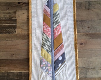 Modern quilted feather wall hanging