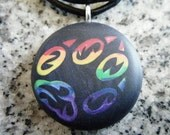 Rainbow FOX Paw Print  hand carved on a polymer clay midnight blue pearl color background. Pendant comes with a FREE necklace