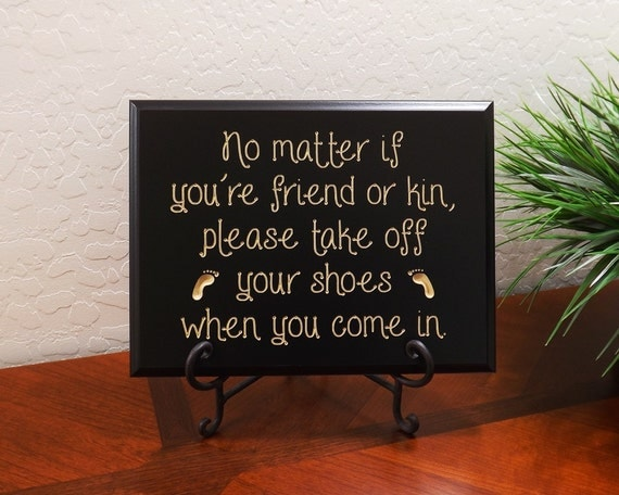 Decorative carved wood sign with quote no matter if Taking shoes off in house etiquette