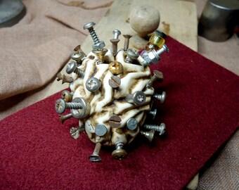 Handmade steampunk brain sculpture totally full of screws