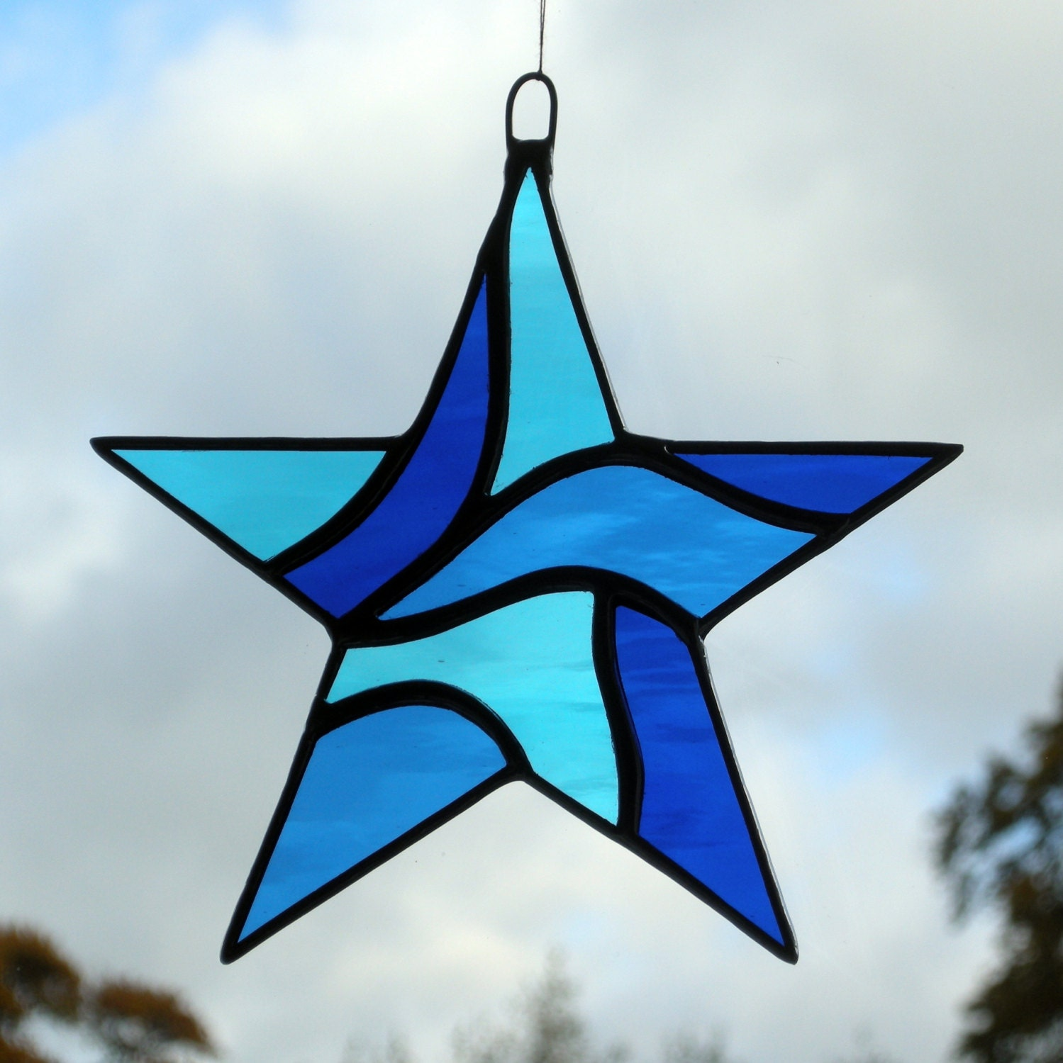 Stained glass star abstract in blues
