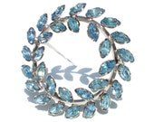 Blue Rhinestone Vintage Brooch in Wreath of Marquise Stones on Sterling Silver Setting - Signed Star Art Formal Vintage Costume Jewelry