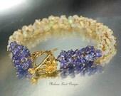 Tennessee's Iris  - Ethiopian Opal, Tanzanite, Gold Bracelet