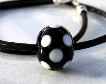 Lampworked Black Glass Bead with White Dots, leather Rem, Sterling Silver Finish and Claps