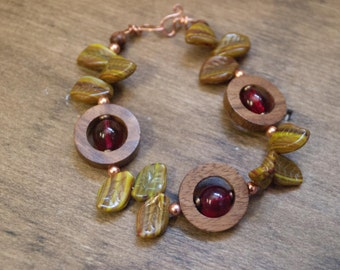Cherry Tree Bracelet featuring olive green Czech glass Leaves cherry red rounds in wood rings from India copper seed beads boho nature