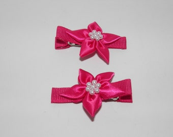 Hot pink satin flower clip with pearl beads.