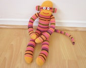 Friendly orange and magenta striped sock monkey doll - orange, black, and pink