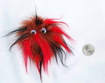 Brown, Red, and Black Monster Fridge Magnet