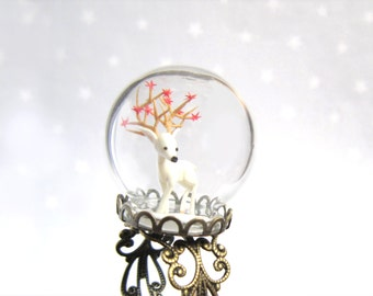 Woodland Terrarium Ring globe with white Deer in snow and red stars in his antlers.