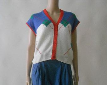red cream blue and green diamond plaid cap sleeve color block sweater shirt top small. medium