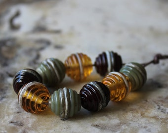 handmade lampwork beads ribbed organic rounds in amber jade and chestnut