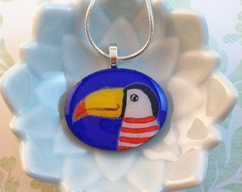 Hand Painted Toucan with Striped Shirt Pendant by Megumi Lemons