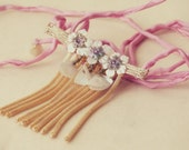 Necklace w/ sumptious antique French vanilla celluloid applique, w/ real gold tassel, hung from pink silk cord, romantic spring bride