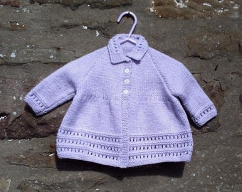 "Hand knitted baby girls lilac collared matinee swing coat / jacket. 18"" chest."