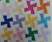 Doll windmill quilt done in various colors