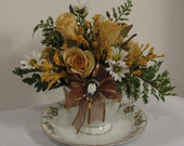 Cup and Saucer Floral Arrangement