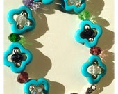 Turquoise flower necklace // faceted multi color crystals