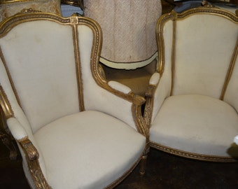 Bergere Chairs. Parlor Chairs. Antique Gilded Wood White Upholstery Living Room Decor. Elle Decor Feature. Southern Living.