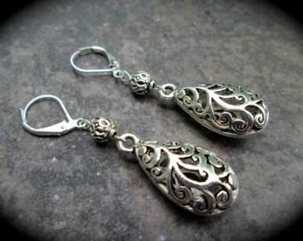 Silver filigree dangle earrings teardrop shaped silver filigree dangles lever backs or shepherd hooks