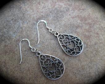 Silver filigree teardrop shape dangle earrings with heart detail and sterling silver ear wires Heart earrings