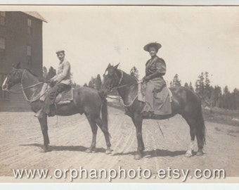 Vintage/Antique beautiful photo of a man and woman on horses