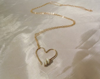 Hammered Heart puka shell necklace.