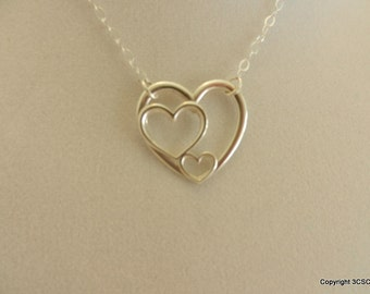 Sterling Silver three hearts Necklace on a Sterling Silver cable chain.
