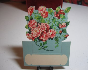 Vintage 1940's-50's unused die cut place card colorful pink flowers on blue background