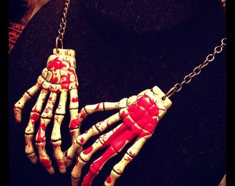 Bloody skull hand necklace