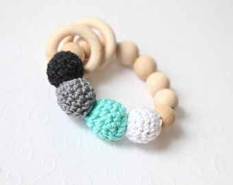 Teething ring toy with crochet wooden beads. Rattle for baby. Green mint/ magic mint, black, white, grey wooden teether